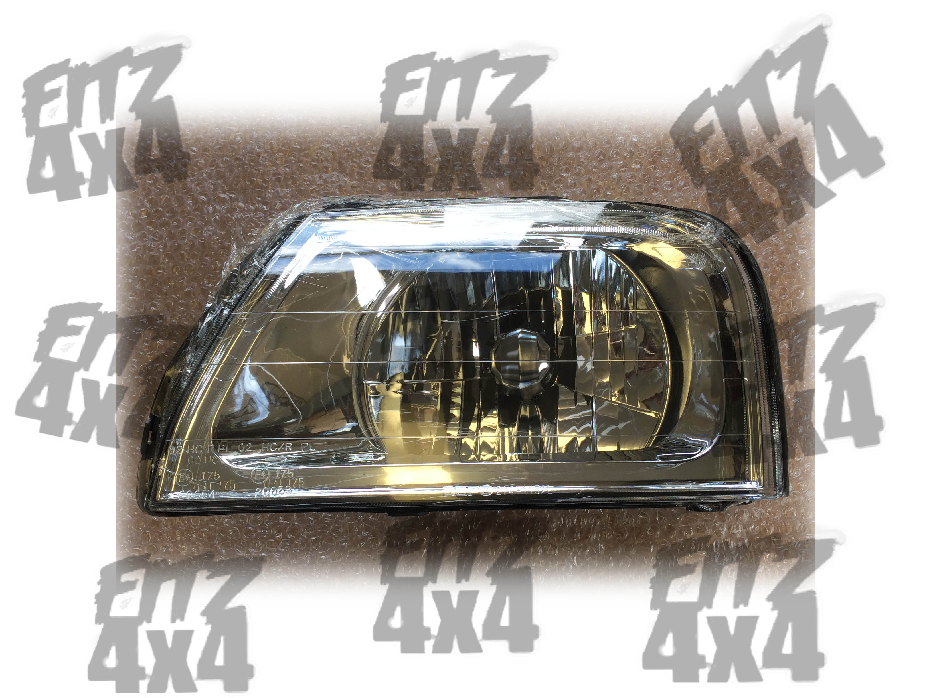 Mitsubishi L200 front left headlamp